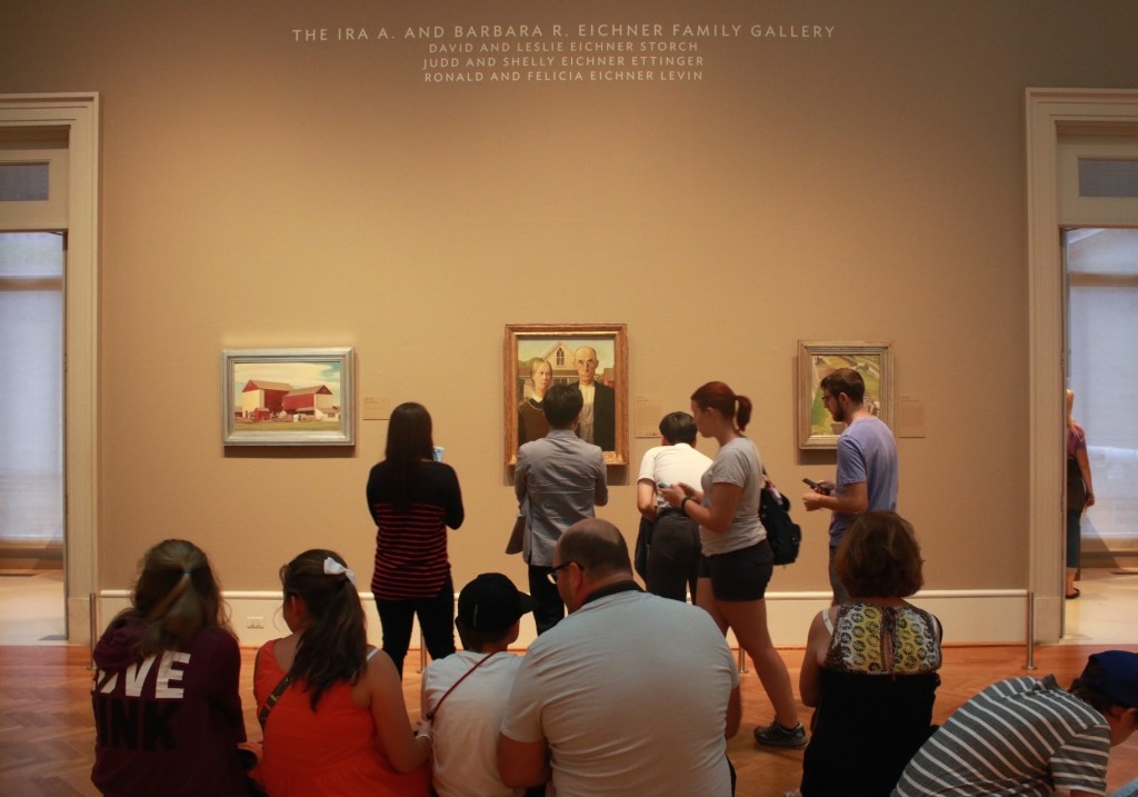 """Museum-goers crowd around """"American Gothic"""" by Grant Wood @ the Art Institute of Chicago"""